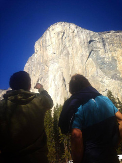 Tommy Caldwell and Chris Sharma studying the line of Dawn Wall up El Capitan, Yosemite