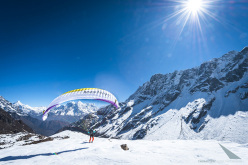Ines Papert taking off with her paraglider in Nepal