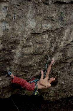 Adam Ondra climbing the crux move of his Vasil Vasil 9b+ at Sloup in the Czech Republic