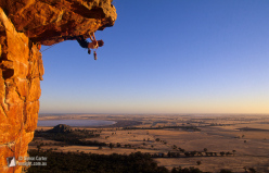 Venus Kondos, the classic roof climb Kachoong (21), The Northern Group, Mount Arapiles, Victoria, Australia.