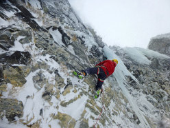 Giancarlo Bazzocchi climbing L'analfabeta in Scottish conditions...