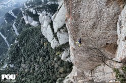 Iker Pou climbing the route Tarragó at Montserrat, Spain