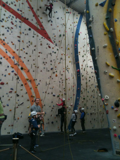 Young climbers using helmets in an indoor climbing wall in London