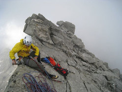 David Lama on the summit of Desperation of the Northface, Zillertal Alps, Austria.