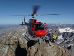 Helicopter working at altitude on Monte Disgrazia, 3678 m