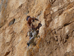 Manolo during the first ascent of Mago e Megu at Toirano