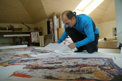Simone Pedeferri drawing the treasure map for the Melloblocco 2014