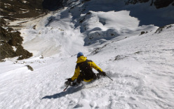 Davide Capozzi and Julien Herry snowboarding the NE Face of Testa di Valnontey on 19/05/2014