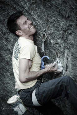 Mauro Dell'Antonia climbing Mai più colla 8c, Rocca Pendice