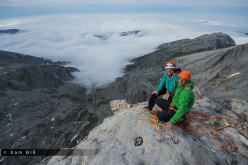 Cédric Lachat and Nina Caprez on the summit of Orbayu, Naranjo de Bulnes, Picos de Europa, Spain