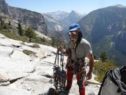 Roberto Iannilli on the summit of El Capitan, Yosemite after having climbed Tangerine Trip