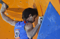 Dimitri Sharafutidonv competing at 2011 Bouldering World Championship at Arco