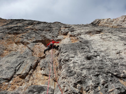Simone Banal setting off up the 5th pitch of Scintilla (450m, VIII) East Face of Brenta Alta.