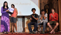 Kay Rush and Giulia Delladio reveal the winners of the La Sportiva Competition Award, next to Sachi Amma, Urko Carmona Barandiaran and Dmitrii Sharafutdinov