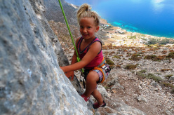 A young girl climbing at Odyssey