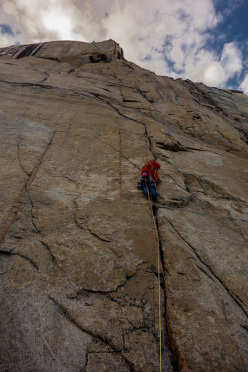 Nicolas Favresse on the perfect splitter crack of Life on the kedge on the East face of Turret, Baffin Island.