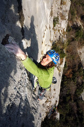 Florian Riegler on the jugs after the crux roof of Pandora
