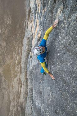 Rolando Larcher climbing pitch 3, 7b+