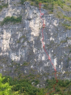 Peter Moser making the first ascent of L'ultimo dei selvaggi (200m, 7b max, 7a oblig), Palu, Valsugana.