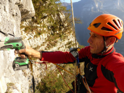 Beppe Ballico substituting the bolts on via Superavanzi, Pilastro dei Barbari, Valsugana