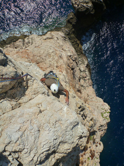 Making the first ascent of Sfida al Mistral, Isola Foradada, (Capo Caccia, Alghero), first climbed by Marco Marrosu and Filippo Derudas on 31 August 2014.