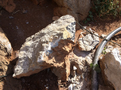 The large chunk of rock and the belay used by Stefan Rass at San Vito lo Capo