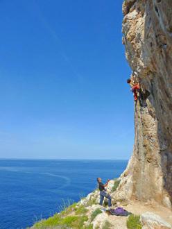 Maurizio Oviglia and Cecilia Marchi climbing on a rebolted route at Casarotto, Capo Caccia (Alghero, Sardinia)