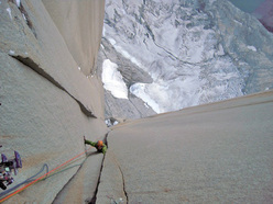Offwidth climbing up an icy chimney on the South African Route.