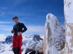 Ragni route, Cerro Torre: Francesco Salvatera, behind him the West Face of Torre Egger.