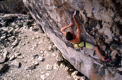 Jerry Moffatt making the first ascent of Liquid Ambar (F8c/+) at Lower Pen Trwyn, Wales in 1990. Liquid Ambar is dedicated to the memory of Jerry's younger brother, Toby.