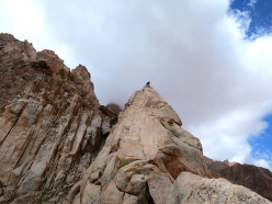 Climbing at Los Arenales in Argentina: on the top of El Cohete