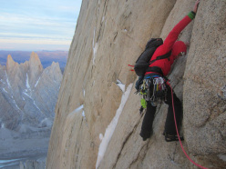 Alex Honnold starting up the third pitch of Directa de la Mentira, on the north face of Cerro Torre, late in the day