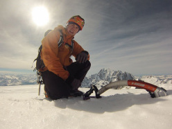 Tom Ballard enjoying the sun on the summit of Grandes Jorasses after having climbed the Colton - Macintyre route in 3 hours and 20 minutes.
