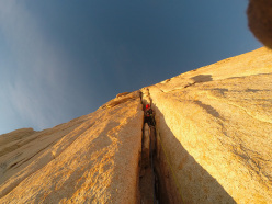 Luca Schiera climbing the Goretta Pillar at first light.