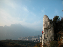 Climbing Cato/Zulu 6b+ at Nago,one of the most popular crags at Arco, Italy
