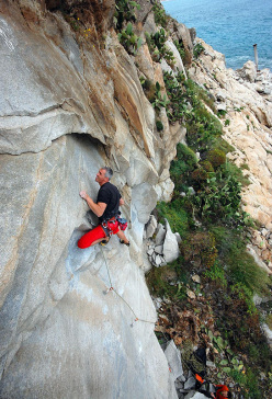 Paolo Contini climbing Rock Girls 7a at Villasimius, Sardinia