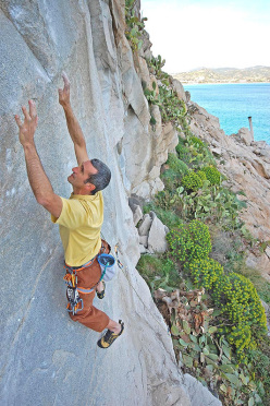 Maurizio Oviglia balancing his way up Braille Trail (7c/7c+) at Villasimius, Sardinia