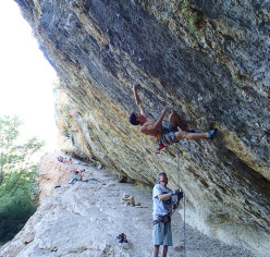 Matteo Menardi climbing at Rodellar, belayed by Sandro Neri.