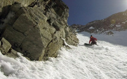 Davide Capozzi and Julien Herry snowboarding the NW Couloir of the North Face of Monte Emilius, Valle d'Aosta on 13/04/2015 .
