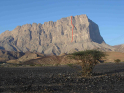 The South Face of Jebel Misht, Oman, and the line of ascent of