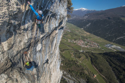 Rolando Larcher climbing pitch 8, belayed by Luca Giupponi.