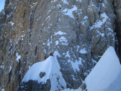 During the first winter ascent of  Via Esposito – Butta up the North Face of Langkofel, Dolomites: Alex Walpoth joining the Pichl route