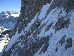 During the first winter ascent of  Via Esposito – Butta up the North Face of Langkofel, Dolomites: on the upper reaches of the route, the major difficulties have been climbed