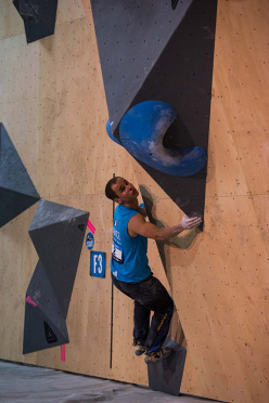 competing in the Bouldering World Cup 2015 at Toronto