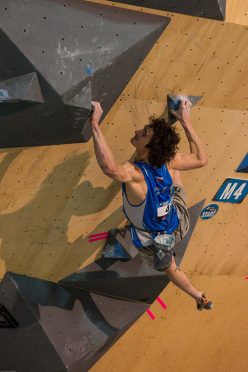 Adam Ondra competing in the Bouldering World Cup 2015 at Toronto