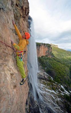 Maurizio Oviglia climbing pitch 3 of Carpe Diem.