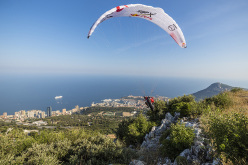 Paul Guschlbauer (AUT1) performs at the finish during the Red Bull X-Alps Peille, France on July 14th 2015