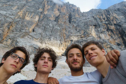 Titus Prinoth, Alex Walpoth, Giorgio Travaglia and Martin Dejori, the first ascentionists together with Marta Mozzati of Via degli studenti, Civetta NW Face, Dolomites.
