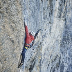 Roger Schäli climbing the 8a+ crux pitch of Odyssee on the North Face of the Eiger, forged together with Robert Jasper and Simon Gietl