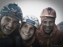Simon Gietl, Roger Schaeli and Robert Jasper on the summit of their new route Odyssee (8a+, 1400m) on the Eiger North Face on 11/08/2015